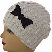 Зимняя теплая шапка бантик