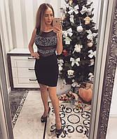 Трикотажное женское платье с открытой спиной