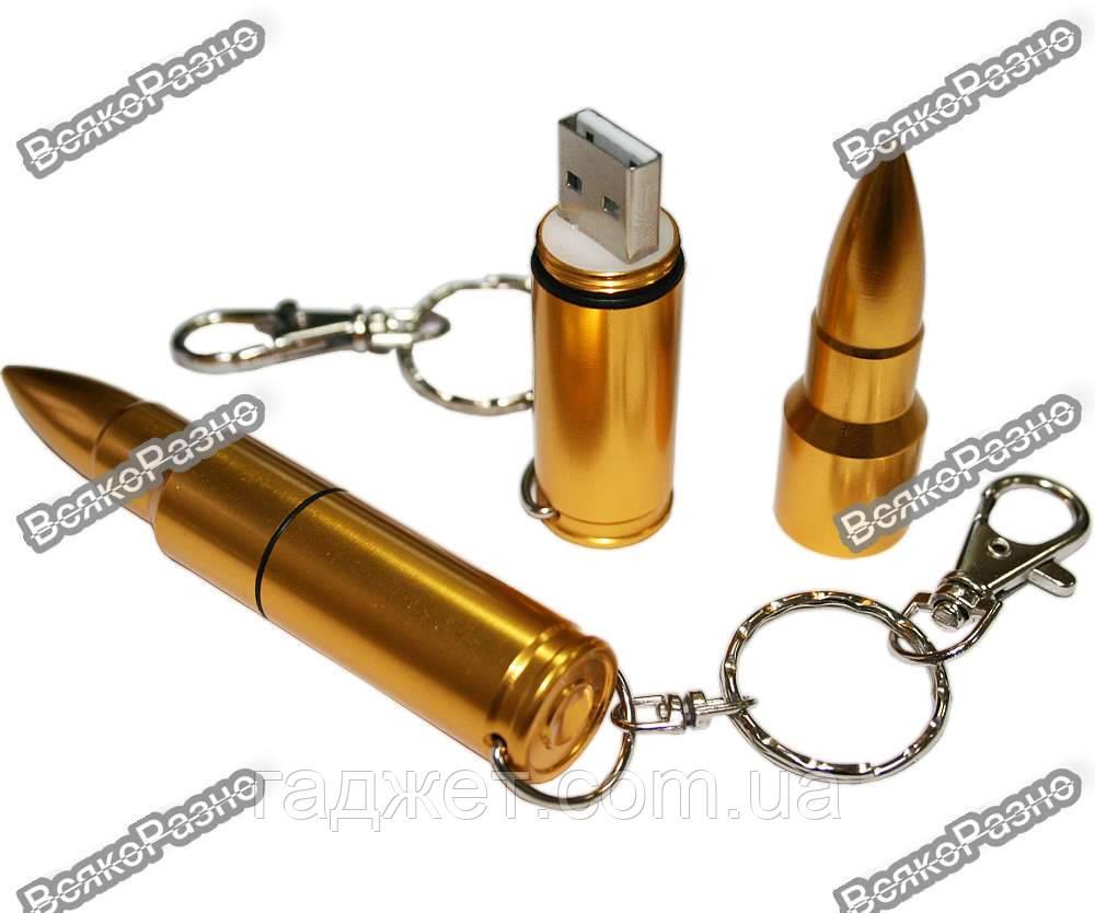 USB Флешка 16 Gb в виде пули золотого цвета.