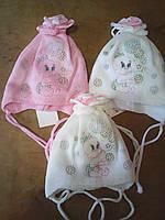 Шапочка вязанная для девочки новоржденной