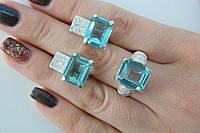 Комплект украшений - кольцо и серьги с голубыми камнями