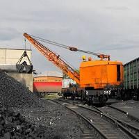 Разгрузка грузов грейферным краном