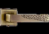 Дверная ручка на квадратной розетке Дюна античная бронза
