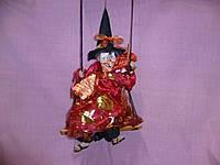 Кукла Баба-яга на кочели в красном - механическая звуковая кукла 52-33сантиметров
