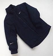 Спортивная тёплая куртка для мальчика синего цвета.
