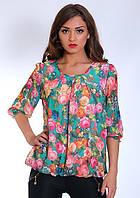 Яркая бирюзовая блуза с цветочным принтом