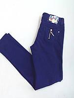 Фиолетовые стильные штаны для девочки-подростка.