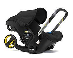 Doona - Детское автокресло-коляска, цвет черный