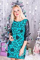 Нарядное прямое  укороченное приталенное зеленое  платье с черными рукавами.