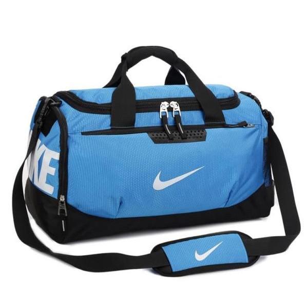 Спортивная сумка Nike голубая с белым логотипом (реплика)