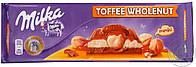 Шоколад Milka Toffee Wholenut (с карамелью и цельным орехом фундуком) Швейцария 300г