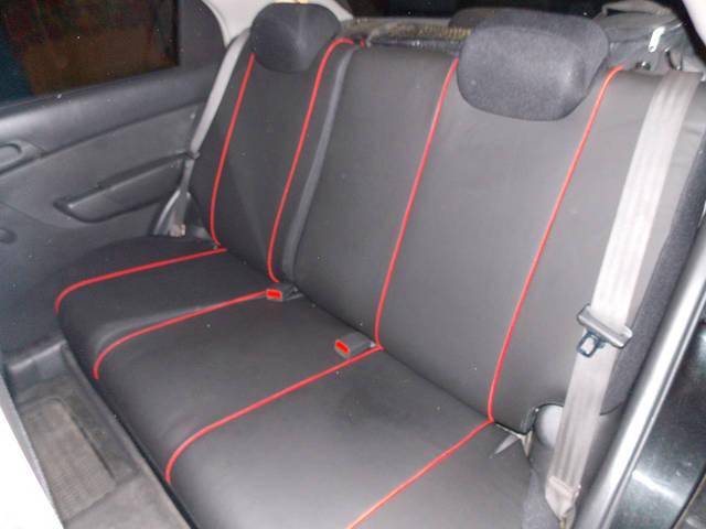 Фотография модельных чехлов на Chevrolet Aveo с вышивкой 4