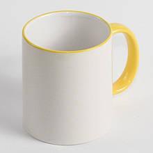Чашка з жовтою облямівкою