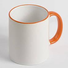 Чашка з помаранчевої облямівкою