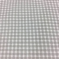 Ткань с мелкой серой клеточкой на белом фоне