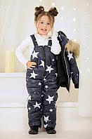 Зимний т.синий комбинезон в звездочку для девочки