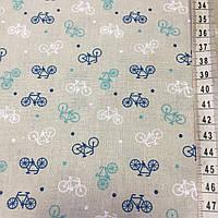 Ткань с маленькими синими, бирюзоывми и белыми велосипедами на бежевом фоне, фото 1