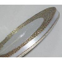 Лента атласная с люрексом-золото 879 белая 6 мм