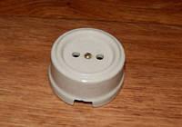 Розетка накладная без заземления RE керамическая белая без подрозетника