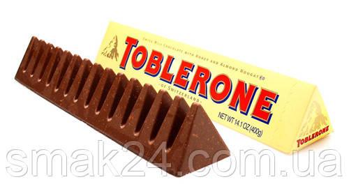 Швейцарский молочный шоколад Tobleron с медом и миндальной нугой