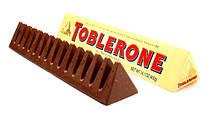 Швейцарский молочный шоколад Toblerone с медом и миндальной нугой 100 г