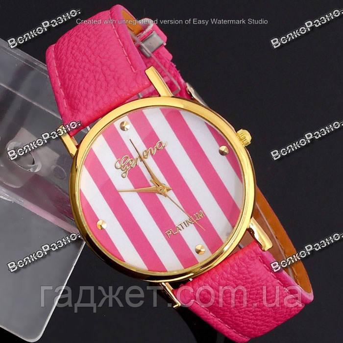 Часы Geneva Platinum розового цвета.