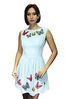 Женское платье с вышивкой - бабочками