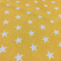 Ткань с белыми звездами на желто-оранжевом фоне, фото 1