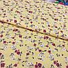 Ткань с мелкими белыми и красными цветочками на желтом фоне, ширина 145 см