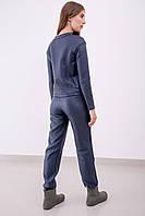 Модные женские кожаные брюки в спортивном стиле