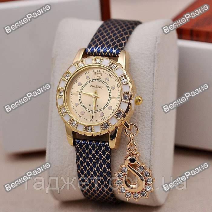 Стильные женские часы Kim Seng с подвеской в виде лебедя с темно синим ремешком.