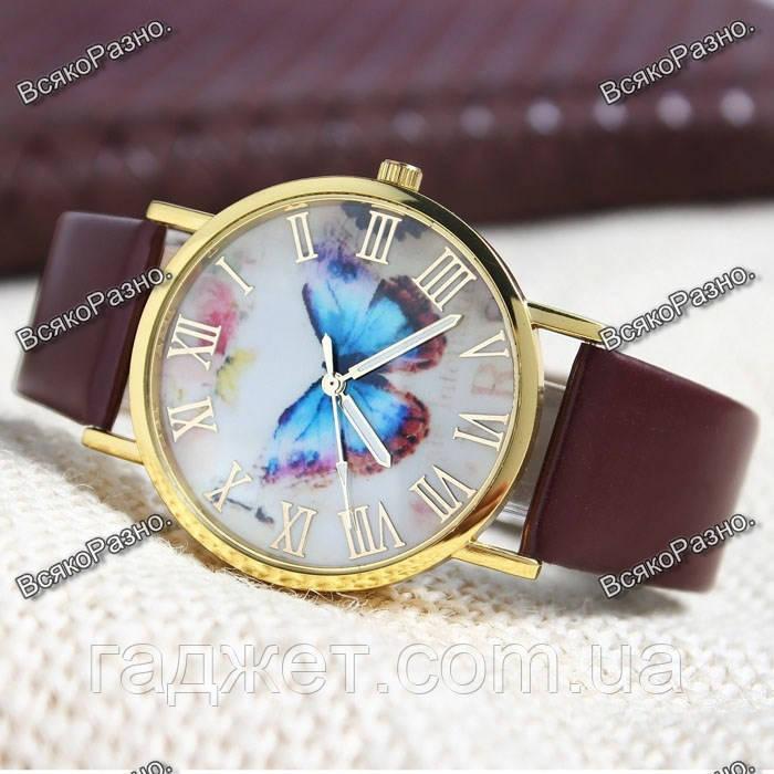 Женские часы с бабочкой коричневого цвета.