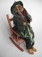 Баба Яга в кресле