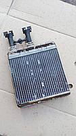 Радиатор печки Opel Astra G.