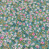 Ткань с мелкими голубыми и бирюзовыми цветочками на малахитовом фоне, фото 1