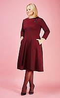 Женское платье больших размеров с росклешенной  юбкой