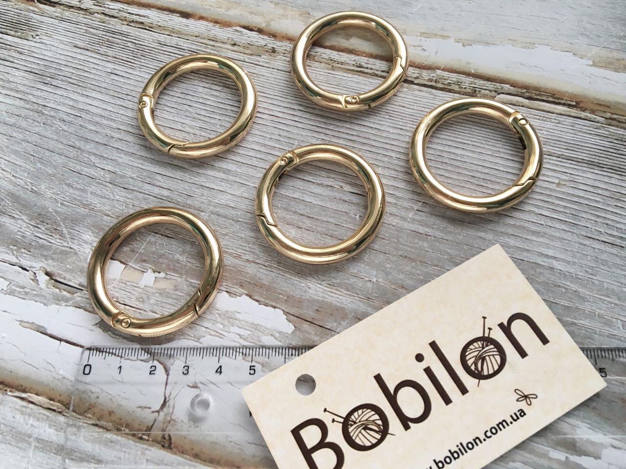 Кільце карабін в кольорі золото, діаметр 30 мм