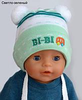 Шапочка для новорожденного с помпонами