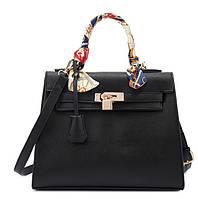 Модная женская сумка черного цвета.