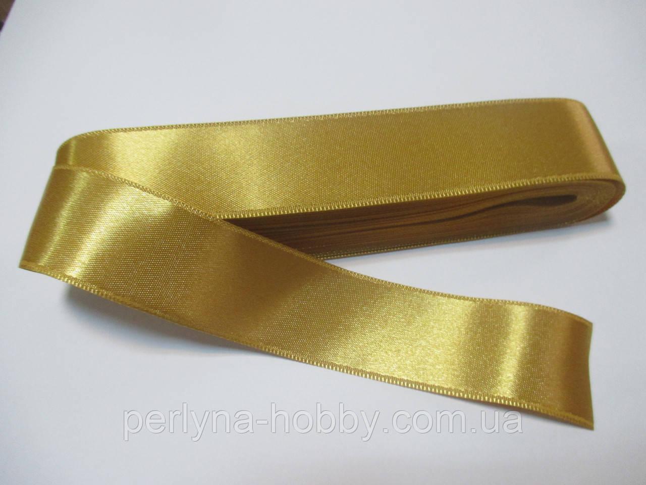 Стрічка атласна  двостороння 3 см Лента атласная двухсторонняя. ( 10 метрів) золотиста G-03-385