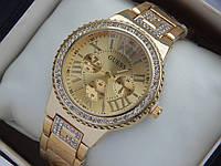 Женские кварцевые наручные часы Guess золотого цвета с римскими цифрами