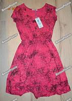Легкое летнее платье розового цвета.