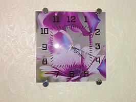 Кроме скинали были изготовлены стеклянные часы. На циферблат был напечатан фрагмент изображения с цветами фиолетовой диморфотеки.