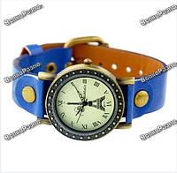 """Кварцевые женские наручные часы """"Эйфелева башня"""" с заклепками и ремешком синего цвета."""