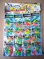 Игрушки динозавры в пакете неоновые