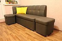 Мягкий диван с пуфом на кухню серого цвета.