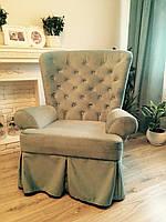Кресло в ткани бирюзового цвета.
