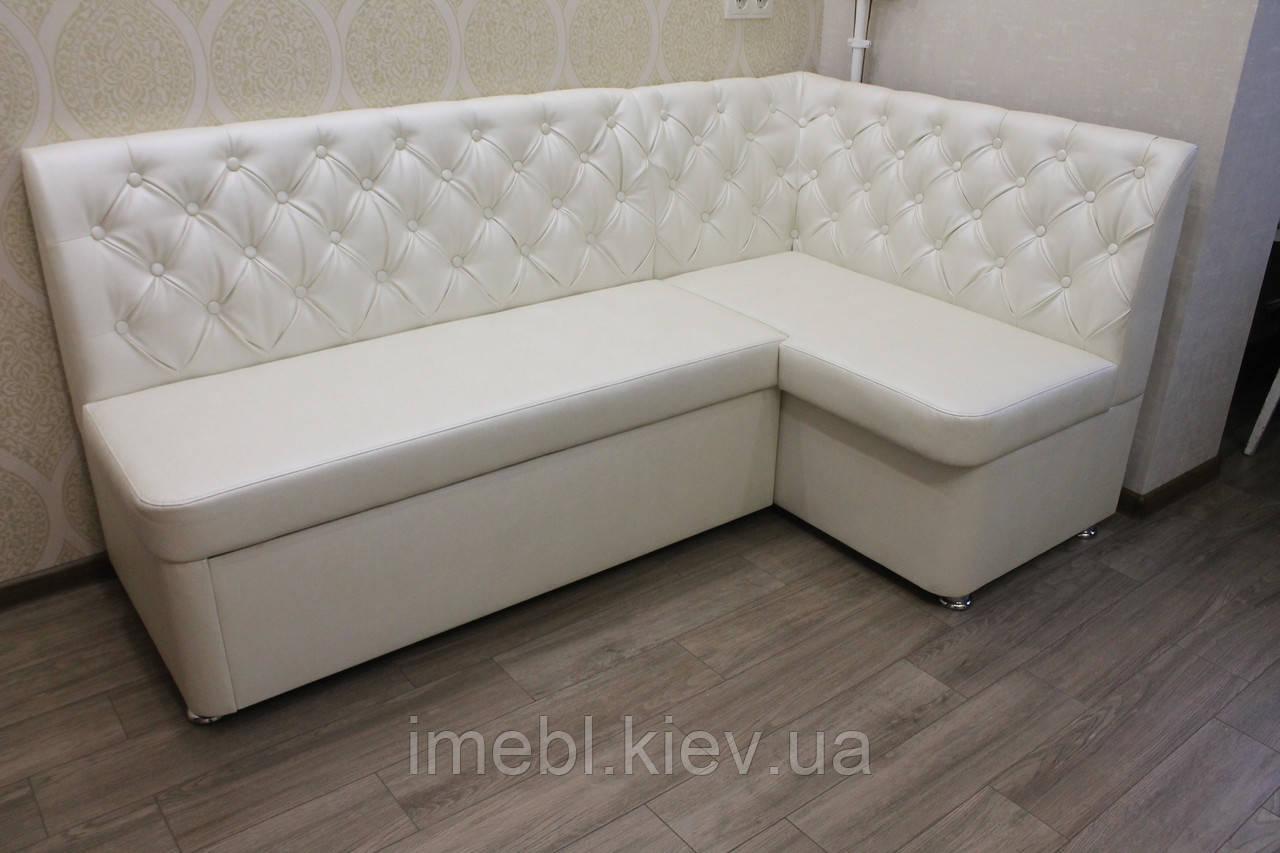 Кухонний куточок білого кольору зі спальним місцем і ящиком для зберігання