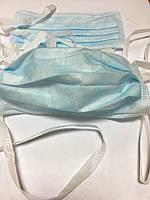 Маска  голубого цвета на завязках