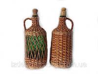 Бутылка обплетена лозой